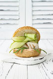 Homemade crispy spring fish burger with spicy chilli mayo on white rustic wooden board over light background. Copy space. Homemade crispy spring fish burger Royalty Free Stock Image