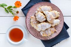 Homemade croissants with fruit jam, decorated with powdered sugar on a ceramic plate Royalty Free Stock Photo