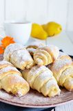 Homemade croissants with fruit jam, decorated with powdered sugar on a ceramic plate Royalty Free Stock Photography