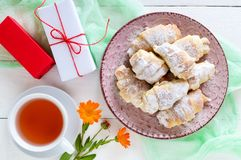 Homemade croissants with fruit jam, decorated with powdered sugar on a ceramic plate Stock Photography