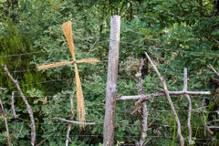 Homemade cross made with planks and hays. Along the way of St. James Stock Images