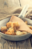 Homemade croutons in a frying pan Royalty Free Stock Image