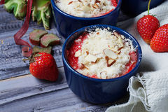 Homemade crumble with strawberry and rhubarb Stock Image