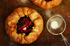 Homemade crusty pies or galette with apples and berries Royalty Free Stock Images