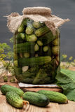 Homemade cucumber preserved in glass jar. Stock Photos