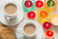Homemade cup of coffee and cookies surrounded by candles, hygge time Stock Images