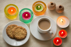 Homemade cup of coffee and cookies surrounded by candles, hygge time. View of the Homemade cup of coffee and cookies surrounded by candles, hygge time Royalty Free Stock Photos
