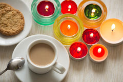 Homemade cup of coffee and cookies surrounded by candles, hygge time. View of the Homemade cup of coffee and cookies surrounded by candles, hygge time Royalty Free Stock Image
