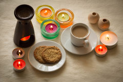 Homemade cup of coffee and cookies surrounded by candles, hygge time. View of the Homemade cup of coffee and cookies surrounded by candles, hygge time Stock Photos