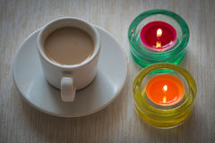Homemade cup of coffee surrounded by candles, hygge time Royalty Free Stock Image