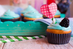 Homemade cupcake on Valentine`s Day. Homemade cupcake with cream on holiday Stock Photography