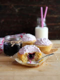 Homemade cupcakes with berry jam and cream cheese Stock Images