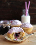 Homemade cupcakes with berry jam and cream cheese frosting Stock Image