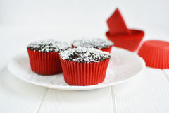 Homemade cupcakes with chocolate glaze and coconut Royalty Free Stock Photos
