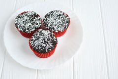 Homemade cupcakes with chocolate glaze and coconut Royalty Free Stock Photo