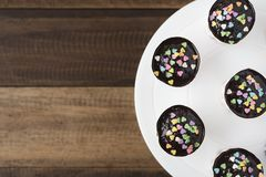 Homemade cupcakes on display on wooden table. With lovely confectionery.with copy space Stock Image