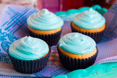 Homemade cupcakes with mint cream. On a wooden tray stock photo