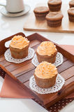 Homemade cupcakes served on kitchen table. Royalty Free Stock Images
