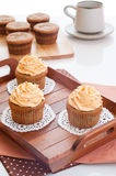 Homemade cupcakes served on kitchen table. Royalty Free Stock Photos