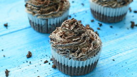 Homemade cupcakes with tender chocolate cream