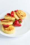 Homemade curd fritters with strawberry on a white plate Stock Image