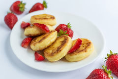 Homemade curd fritters with strawberry on a white plate Stock Photography