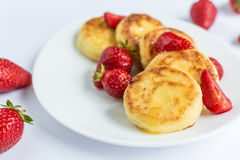 Homemade curd fritters with strawberry on a white plate Royalty Free Stock Image