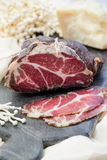 Homemade cured meat. Capocollo. Dried cured pork. Coppa. Aged pork meat. Charcuterie. Capocollo. Dried cured pork. Coppa. Aged pork meat. Charcuterie. Smoked Royalty Free Stock Image