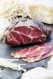 Homemade cured meat. Capocollo. Dried cured pork. Coppa sliced on pieces. Aged pork meat. Charcuterie. Royalty Free Stock Photo