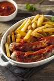 Homemade Currywurst and French Fries Stock Photo