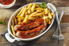 Homemade Currywurst and French Fries Stock Photography
