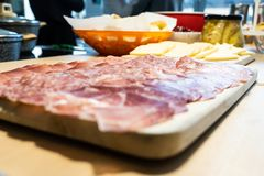 Homemade cut of salami, ham and speck royalty free stock photos