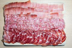 Homemade cut of salami, ham and speck stock image