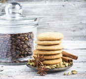 Homemade Danish pastry cookies flavored with cardamom and cinnamon stacked pile surrounded by spices  a jar of coffee Royalty Free Stock Image