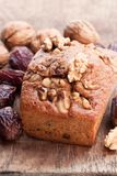 Homemade date and walnut loaf cake on old wooden table stock images