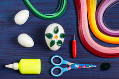 Homemade decor Easter eggs in the technique of quilling. Step 3 Royalty Free Stock Photo