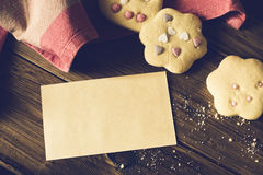 Homemade Decorated Cookies With Paper Card On Wooden Table. Royalty Free Stock Photo