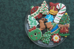Homemade Decorated Cutout Christmas Cookies On Clear Plate,Green Tablecloth Stock Photography