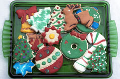 Homemade Decorated Cutout Christmas Cookies On Green Square Dish Royalty Free Stock Images