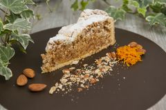Slice of almond cake royalty free stock photography