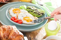 Delicious american breakfast with fried egg, avocado, orange juse royalty free stock photography