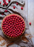 Homemade delicious chocolate cake cheesecake with raspberries on the rustic wooden table. Homemade delicious chocolate cake cheesecake with fresh raspberries on Stock Photography