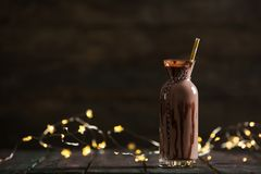 Delicious Chocolate Milk on Woden Background Stock Photos