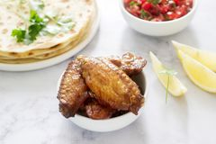 Homemade delicious food of tortillas, salsa and fried wings. Selective focus stock image