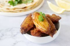 Homemade delicious food of tortillas, salsa and fried wings. Selective focus royalty free stock photography