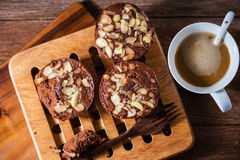 Homemade delicious fresh chocolate almonds cake and hot coffee Stock Images