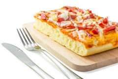 Homemade delicious fresh a slice of pizza on wooden plate. Stock Image