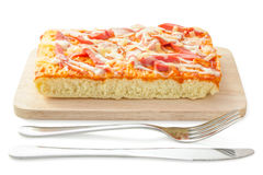 Homemade delicious fresh a slice of pizza on wooden plate. Stock Photography