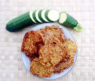 Homemade delicious fritters made from grated zucchini vegetables. Natural food, organically grown vegetable for healthy eating, vegetarian, courgette, veggie royalty free stock image