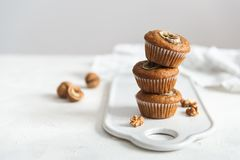 Homemade delicious muffin on white background. Cup cakes with banana and walnut. Side view, copy space stock photos